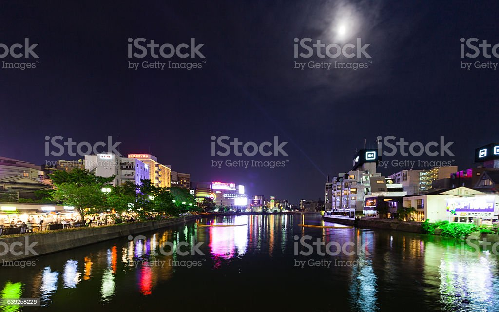 Moonlight on Fukuoka and Naka River stock photo