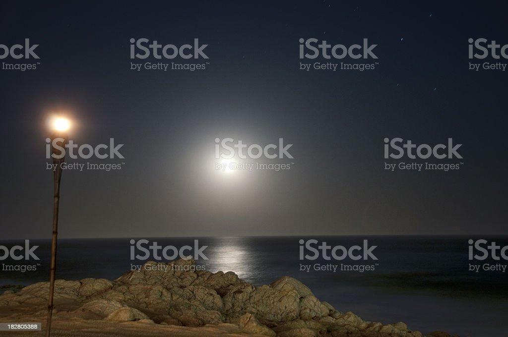 moonlight over a calm ocean (Los Cabos, Mexico) stock photo