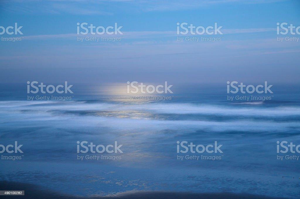 Moonlight over the beach stock photo