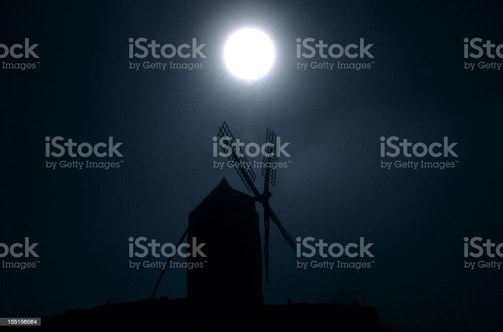 Moonlight over the windmill stock photo
