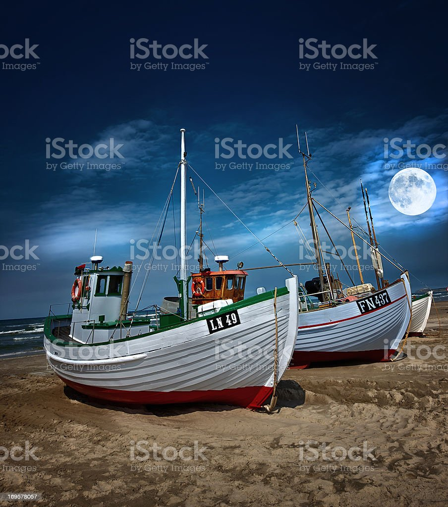 Moonlit boat on the beach stock photo