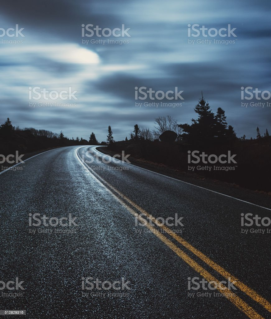 Moonlit Coastal Road stock photo