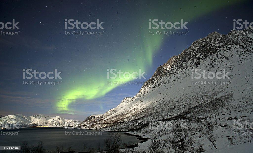 Moonlit mountains and Aurora Borealis. stock photo