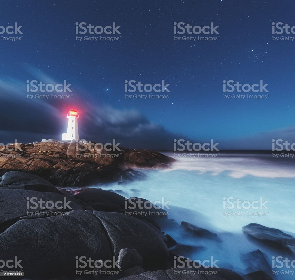 Moonlit Skies at Peggy's Cove Lighthouse stock photo
