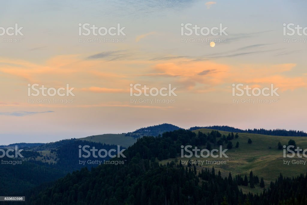 Moonrise in the Apuseni mountains of Transylvania stock photo