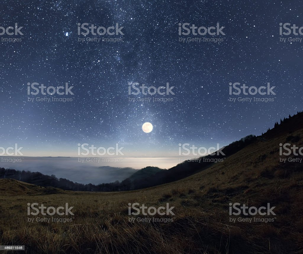Moonrise in the mountains stock photo