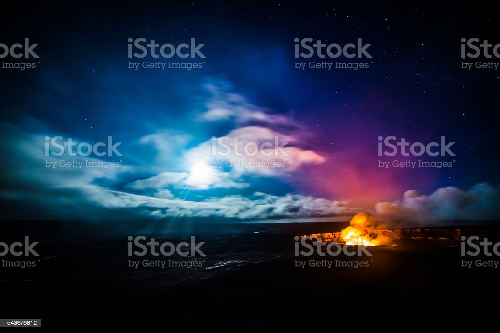 Moonrise over a Volcano stock photo