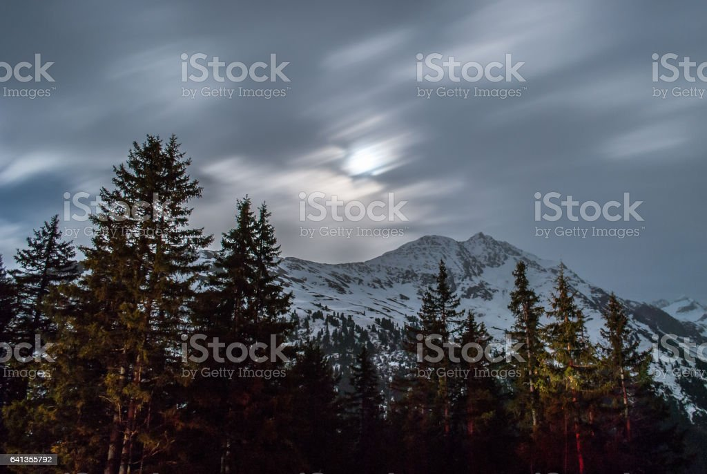 Moonrise over Arlberg mountain in Austria at night stock photo