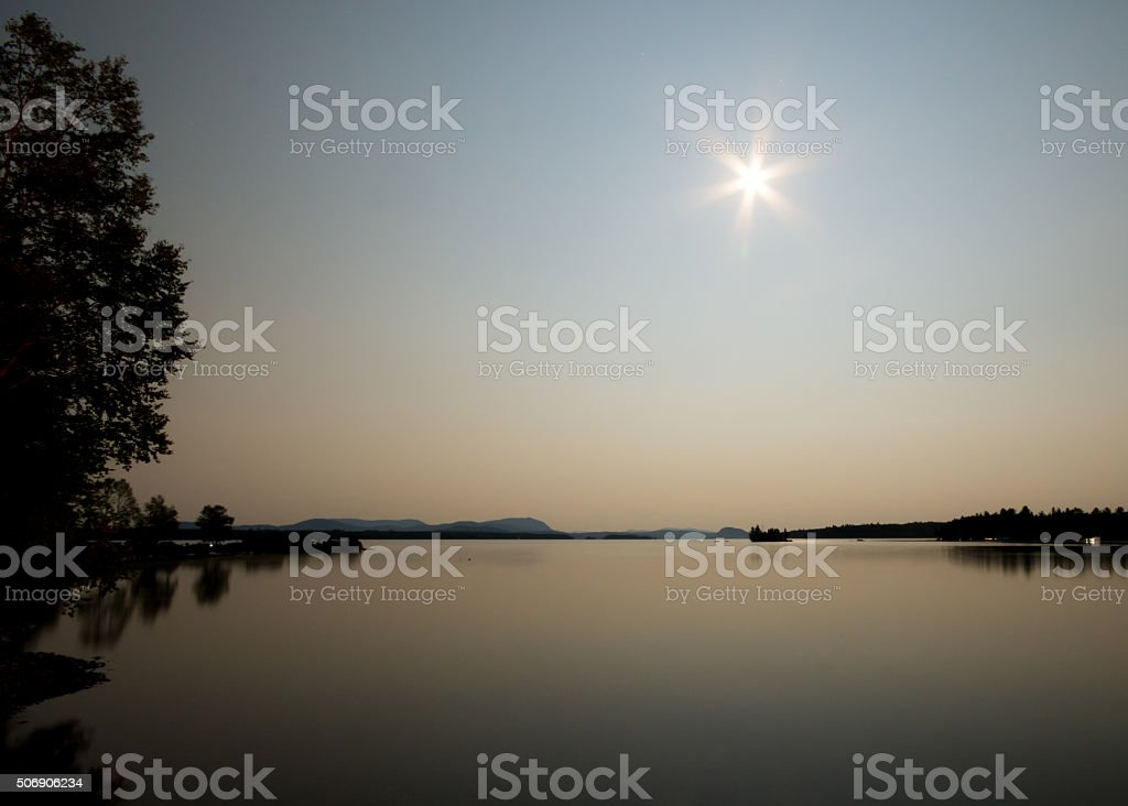 Moonscape Over Moosehead Pastel Colors Glistening Calm Lake stock photo