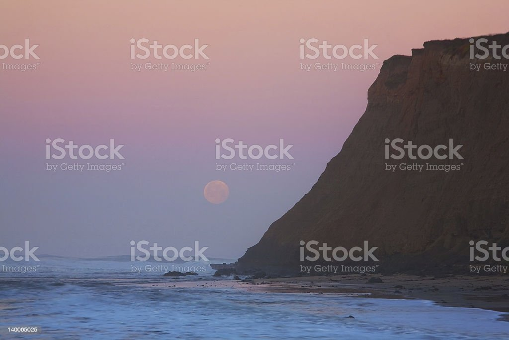 Moonset at Sunrise stock photo