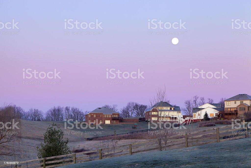 Moonset over a neighborhood royalty-free stock photo