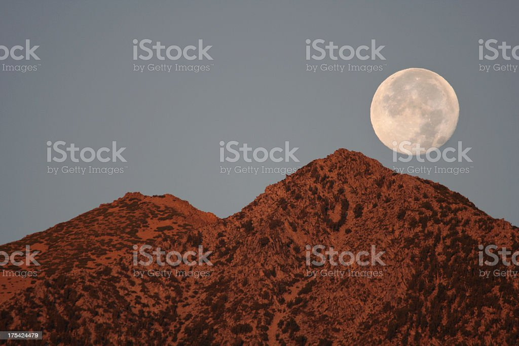 moonset over the sisters stock photo