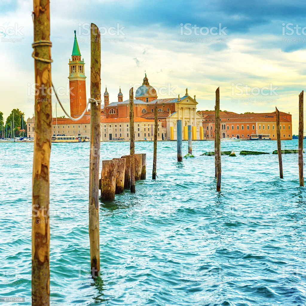 Moorage for gondolas with wooden poles stock photo