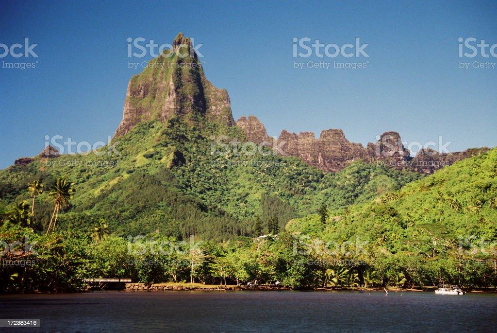 Moorea Tahiti Tropical ocean beach front mountain stock photo