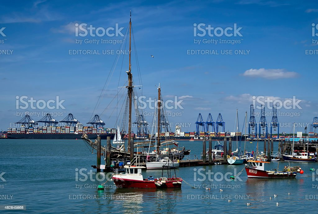 Moored boats at Harwich with Felixstowe Port stock photo