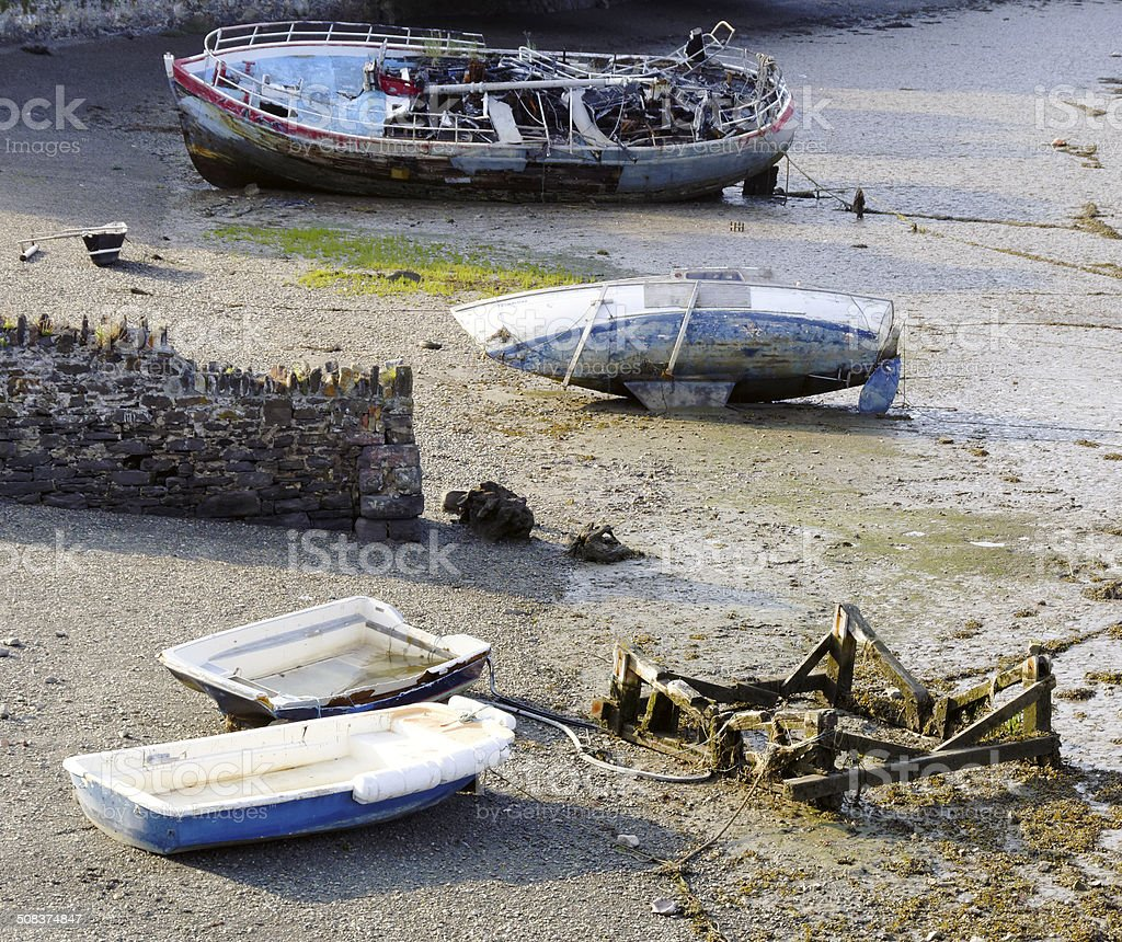 moored boats at low tide stock photo