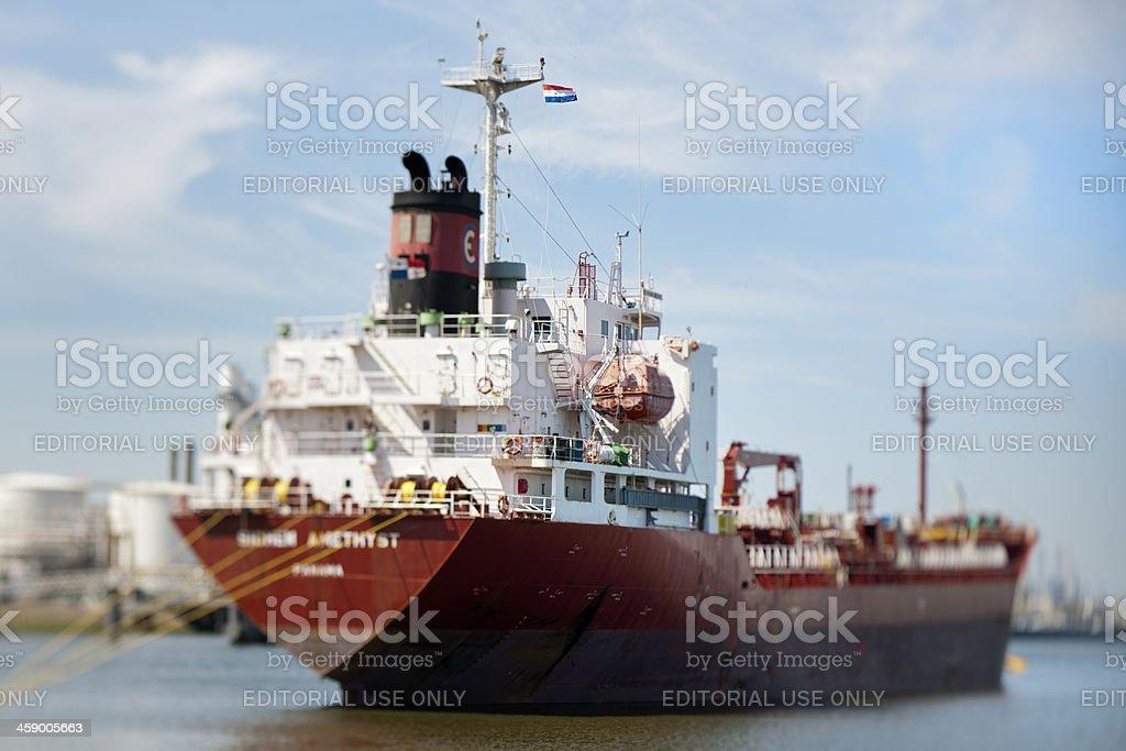 moored cargo ship in harbor stock photo
