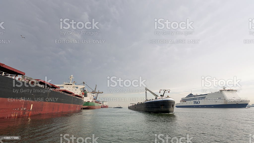 moored cargo ships, sailing barge and ferry in harbor stock photo