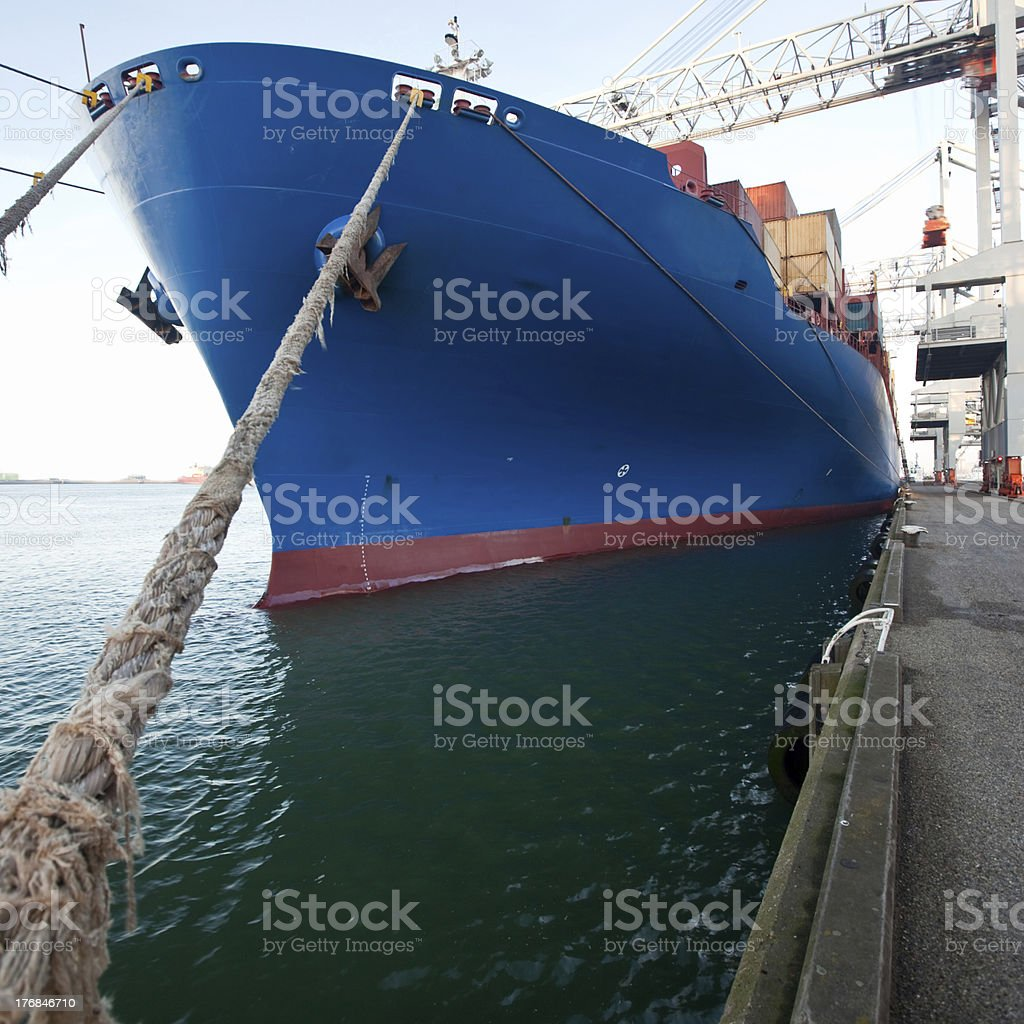 Moored container ship in a harbor royalty-free stock photo