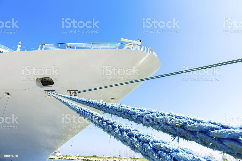 Moored Cruise ship bow with multiple lines royalty-free stock photo