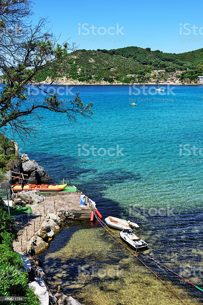 Moored inflatable boats and blue sea, Island of Elba stock photo