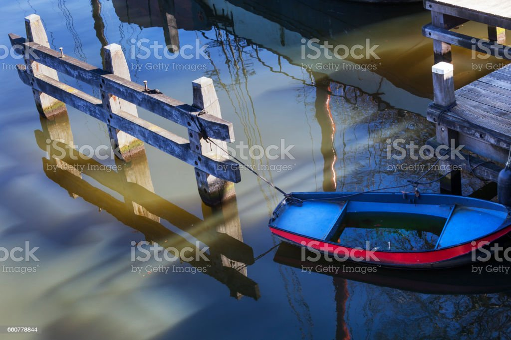 Moored metal rowing boat stock photo