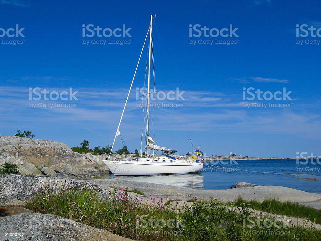 Moored sailboat at small archipelago island in the sun stock photo