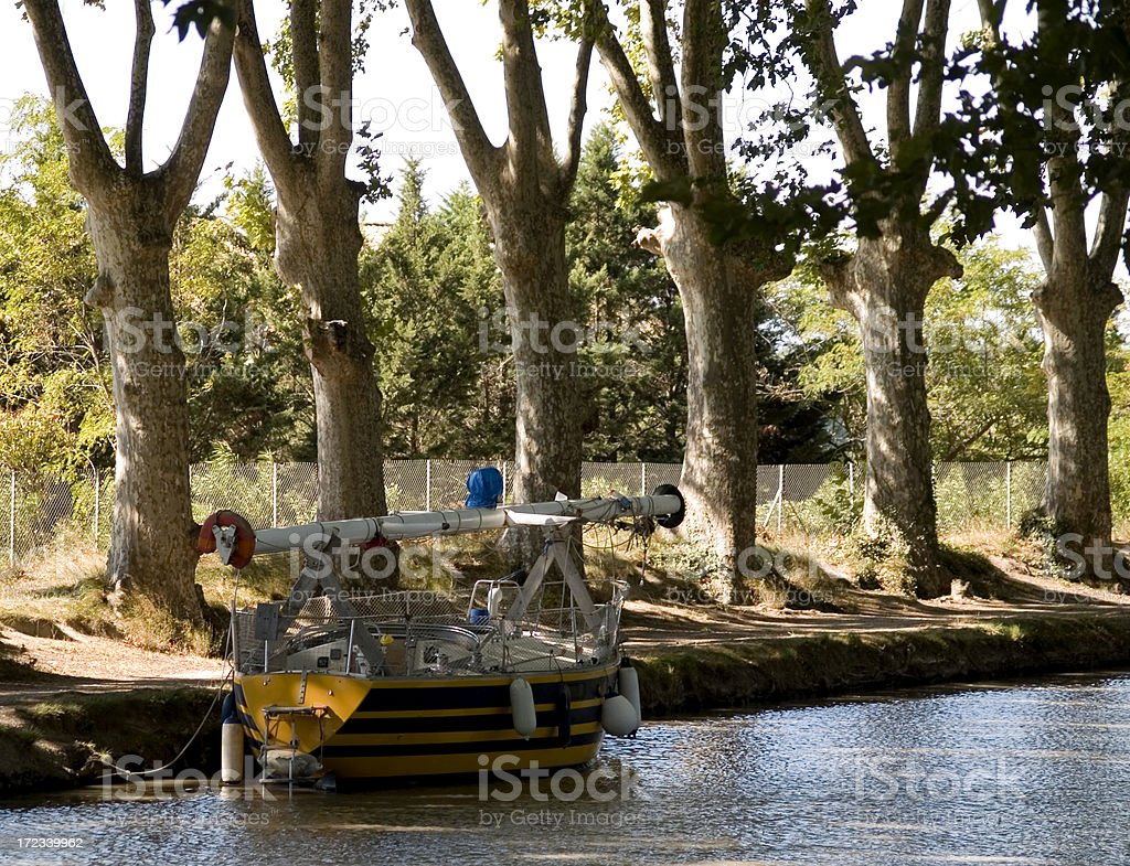 Moored sailboat on a canal stock photo