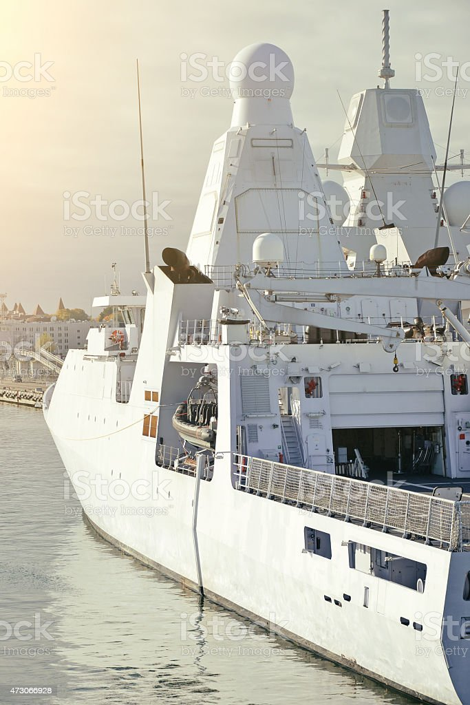 Moored white naval ship with radar. stock photo