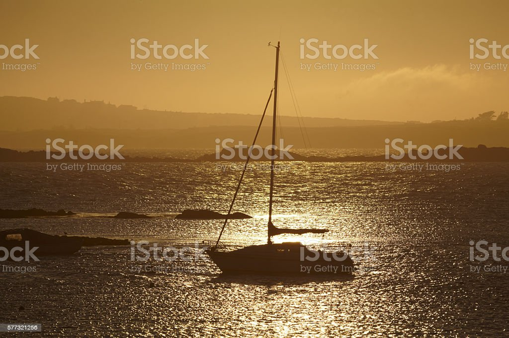 Moored Yacht at Sunset, Rhosneiger, Anglesey, Wales. stock photo