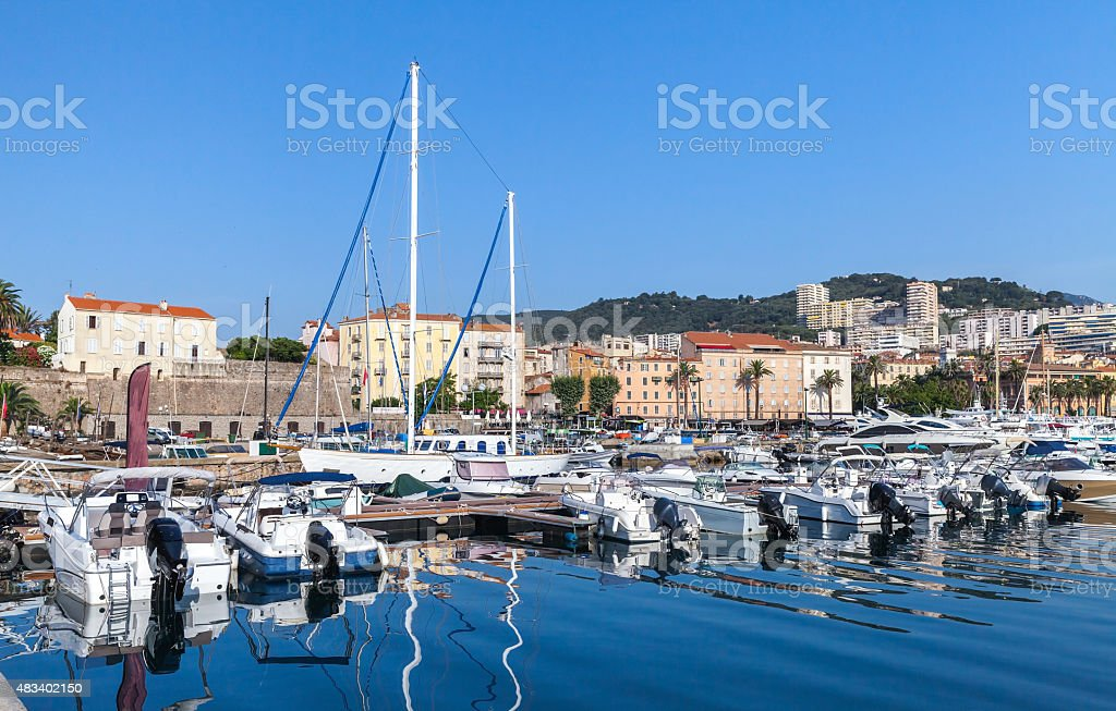 Moored yachts and pleasure boats in port stock photo