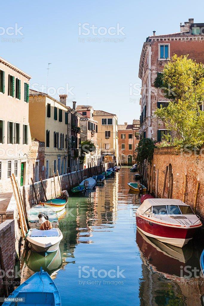 moorindg boats in canal in in Venice stock photo