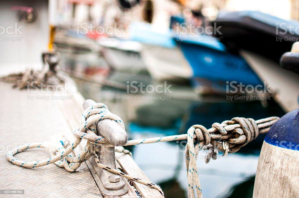 Mooring bollard with ropes stock photo