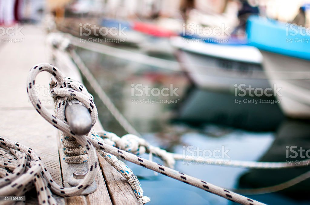 Mooring bollard with ropes stock photo