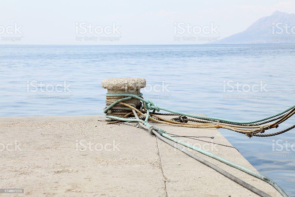 mooring bollards and mediterranean ocean harbour with  ropes  Croatia royalty-free stock photo
