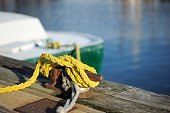 Mooring line on dock with boat in background