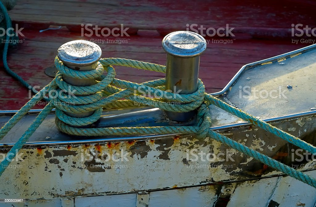 Mooring node closeup on wooden deck of a boat stock photo