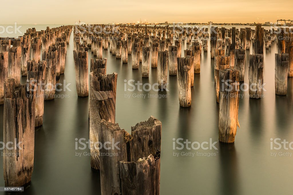 Mooring poles at sunset at Princes Pier stock photo