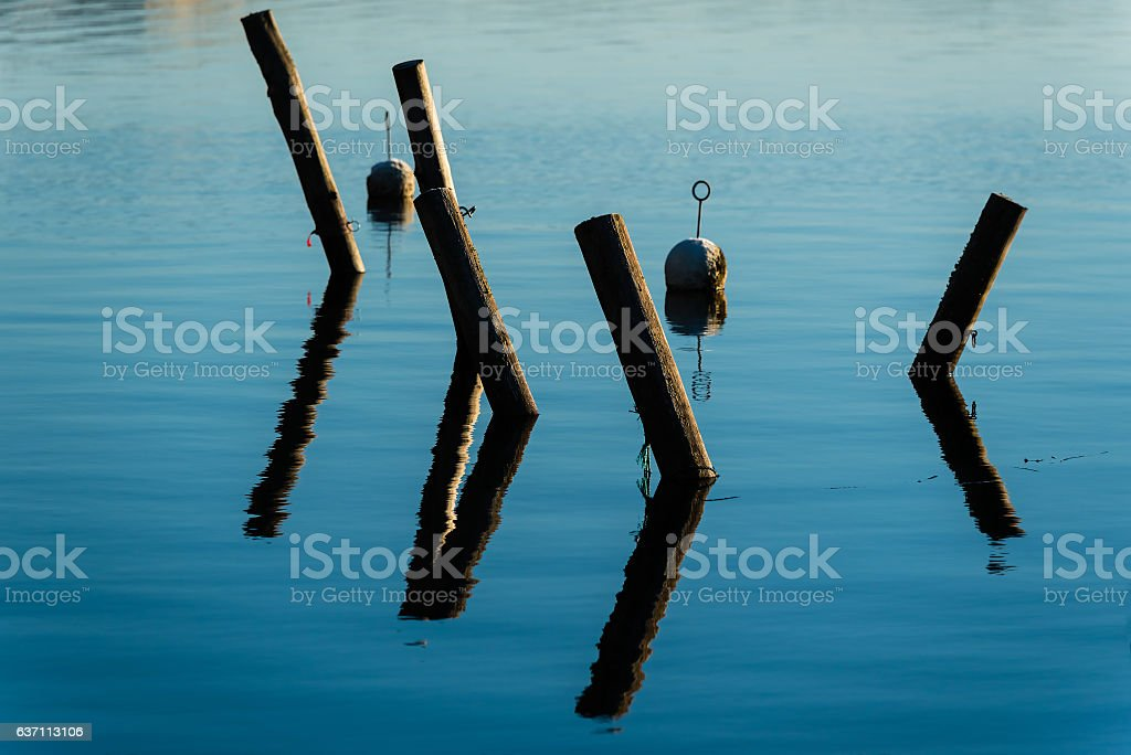 Mooring poles with reflections stock photo