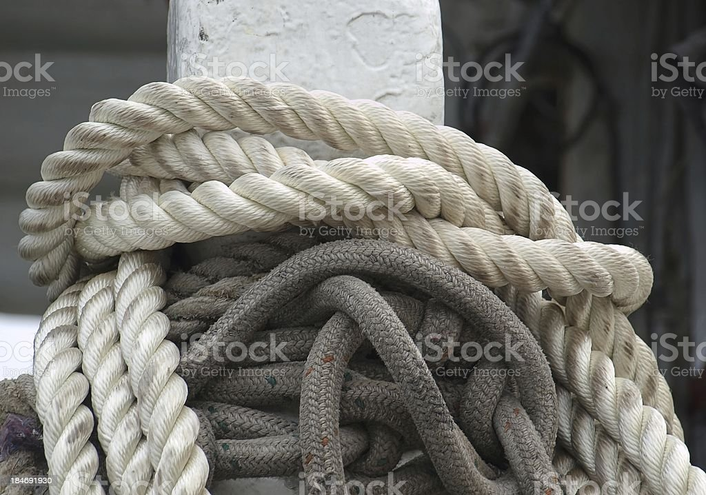 Mooring Post with Thick Ropes royalty-free stock photo