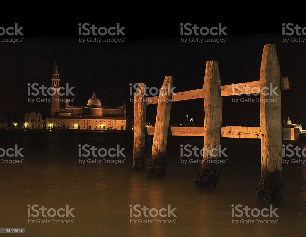 Mooring Posts in a Venetian canal at night royalty-free stock photo