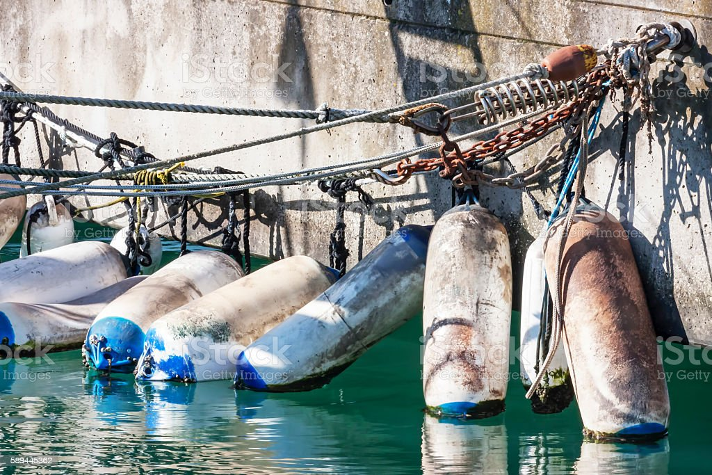 Mooring with fenders at the port stock photo