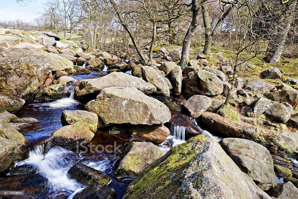 Moorland brook creates rock pools and waterfalls stock photo
