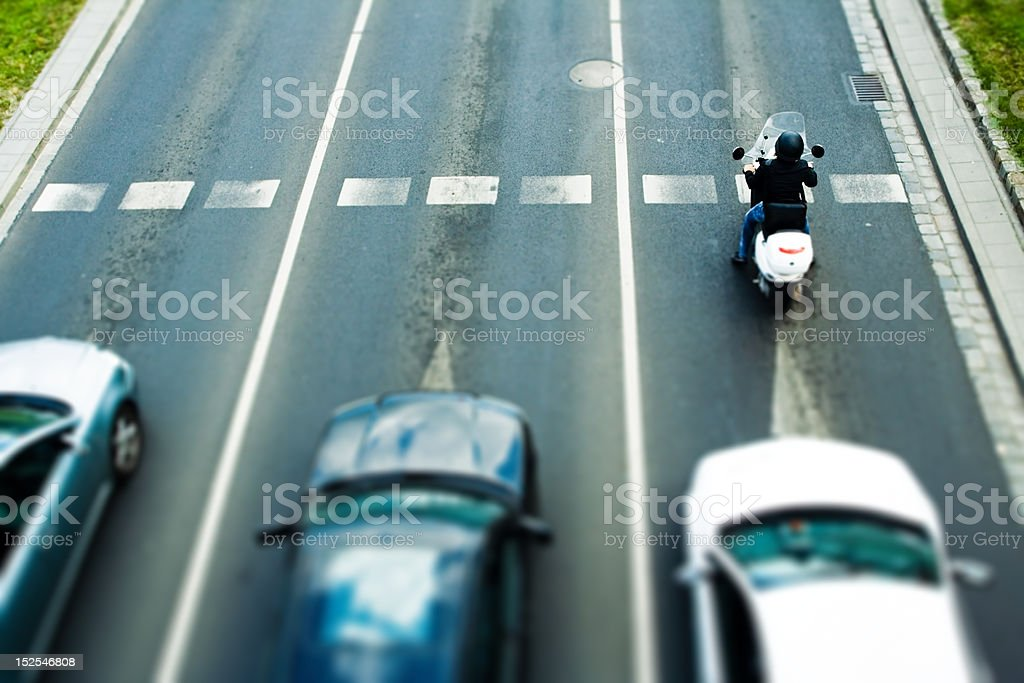 Moped in traffic jam royalty-free stock photo