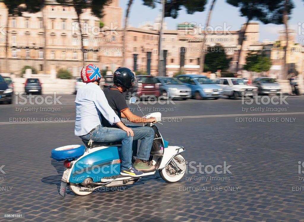 Moped riders in Rome stock photo
