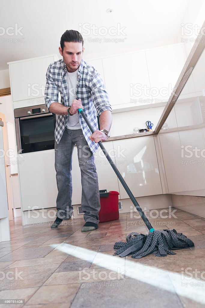 Mopping the Kitchen Floor stock photo