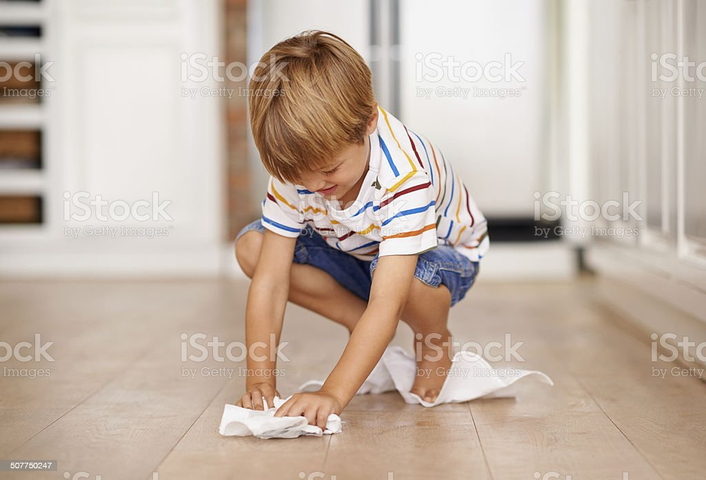 Mopping up before Mom gets here stock photo