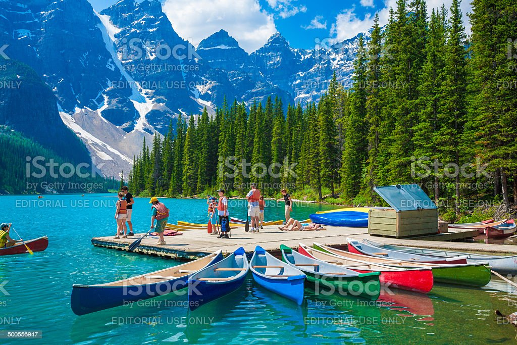 Moraine Lake, Banff, mountains, canoes, tourists, National Park, Alberta, Canada stock photo