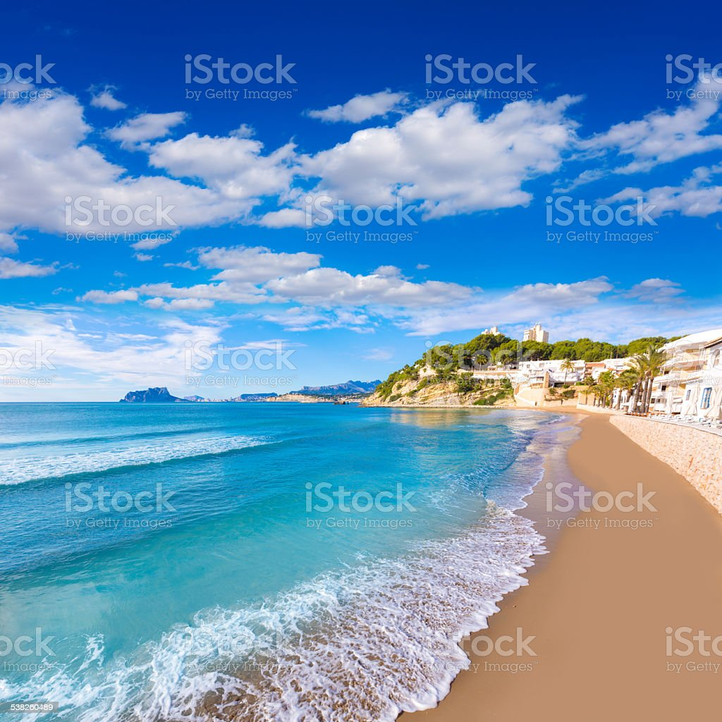 Moraira playa El Portet beach turquoise water in Alicante stock photo