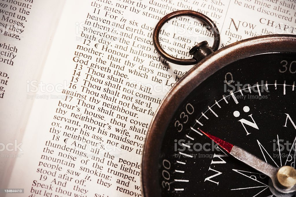 Moral compass with Ten Commandments stock photo